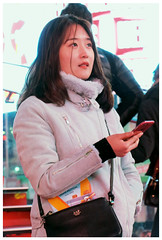 A sense of Wonder and Awe - Times Square, NYC (TravelsWithDan) Tags: woman candid outdoor urban city night phone wonder awe timessquare nyc newyork manhattan canong3x