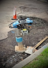 This is Jack (SurFeRGiRL30) Tags: jackhammer machinery roadwork tamper loud noisy big blue menatwork roadcrew pseg repaving paving breaking dirty job nj street curb shovels orangecone gravel asphault