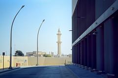 Old Mosque Tower (Doha Sam) Tags: 400 agfa ambisilette analogue chrome coolscan9000ed doha educationcity film hbku hamadbinkhalifauniversity kodak linearscan manualexposure manualfocus negative newportra nikon nikonscan portra400 qf qatar samagnew scan wcmcq iso400 smashandgrabphotocom wwwsamagnewcom