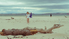Gone for a paddle (Snap_Happy_Chappy) Tags: nikon 35mm innocence weather north sand driftwood child children cloudy windy scotland beach