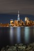 Downtown (Nina Wolfe Photography) Tags: jerseycity freedomtower hudsonriver ny nyc downtownnyc empirestate city cityscape nikon lowermanhattan clear water bluehour reflection libertystatepark fair partlycloudy