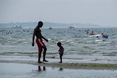 On the beach (lorenzog.) Tags: onthebeach beach beachlife playing mareadriatico marinaromea rivieraromagnola romagna summer heatwave emiliaromagna italy people