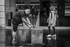 Running Shoes (Leanne Boulton (Away)) Tags: monochrome people urban street candid streetphotography candidstreetphotography portrait streetlife man male posture expression overweight shape form running shoes trainers sneakers laces sport wet weather rain raining tone texture detail depth naturallight outdoor light shade reflection city scene human life living humanity society culture lifestyle canon canon5dmkiii 70mm ef2470mmf28liiusm black white blackwhite bw mono blackandwhite glasgow scotland uk