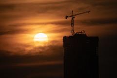 Jupiter Sun, Edmonton (WherezJeff) Tags: alberta canada potain silhouette edmonton edm yeg crane construction skyscraper towercrane md365bl16