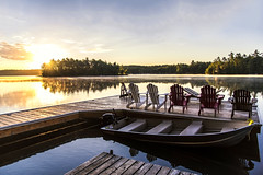 Morning on the lake (mystero233) Tags: morning lake muskoka lakes canada ontario america boat water dock island sunrise sun rays dawn forest tree reflectio outdoor landscape trip travel chair wood relax calm