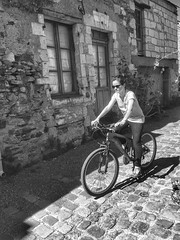 Slow ride on cobblestones (LUMEN SCRIPT) Tags: candid village france people cobblestones blackandwhite bike cyclist riding streetphotography monochrome