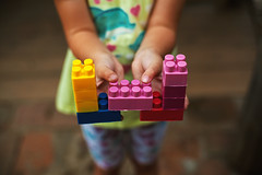 Colorful Toys in Child's Hands (dejankrsmanovic) Tags: small colorful color toys child kid girl body hand grip hold object stilllife arm game play creative creativeness creativity idea imaginary childhood plastic concept conceptual lifestyle young naive cute outdoor playful box puzzle learning growth youth happy skin blur detail closeup