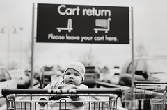 henryscapes, part five (manyfires) Tags: henry boy child baby son family love childhood portrait bw blackandwhite film analog peoplescape people ikea shopping shoppingcart cartreturn pdx portland oregon cart nikonf100 35mm