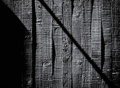 Unparallel_Bars (Peterfacts) Tags: monochrome blackandwhite outdoor shadows highcontrast fence wood weathered tintedimage lines ridges