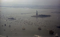 In late afternoon, the sky began to turn a threatening grayish green color as massive thunderstorms slowly worked their way toward Jersey City, New York Harbor, the Statue of Liberty and the armada of Tall Ships celebrating the Bicentennial. July 4 1976 (wavz13) Tags: newyorkphotographs newyorkphotos urbanphotography urbanphotos analog vintageanalog 1970sanalog oldphotographs oldphotos 1970sphotographs 1970sphotos oldphotography 1970sphotography vintagephotographs vintagephotos vintagephotography filmphotos filmphotography vintagenewyorkphotography vintagenewyorkphotographs vintagenewyorkphotos vintagejerseycity oldjerseycity industrialjerseycity 1970sjerseycity cavenpoint cavenpointpier vintagephoto oldphoto jerseycityhistory newjerseyhistory vintagefilm oldfilm vintageboats oldboats antiqueboats sailboats oldsailboats vintagesailboats schooners vintageschooners antiqueschooners fourthofjuly newyorkphotography oldnewyorkphotography oldnewyorkphotos vintagenewyork