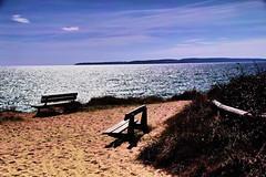Inviting spot. (Fr Paul Hackett) Tags: sunshine sea beach bench sand