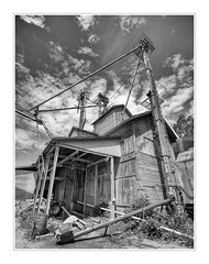 Feed Mill Distortion (MAMowery) Tags: approved wideangle distorted blackandwhite rural clouds