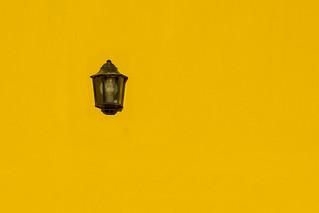 Lamp on a yellow wall II