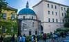 2018 - Hungary  - Pécs - Jakovali Hassan Mosque (Ted's photos - For Me & You) Tags: 2018 cropped hungary nikon nikond750 nikonfx pécs tedmcgrath tedsphotos vignetting jakovalihassanmosque pecsjakovalihassanmosque jakovalihassanmosquepecs church churchdome streetscene street people peopleandpaths pathsandpeople minaret mosque pecshungary buildings windows dome blue bluesky