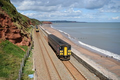 We do like to be beside the seaside (davidvines1) Tags: railroad railway rail train diesel dmu dieselmultipleunit pacer voyager gwr crosscountry dawlish devon sea wall beach cliff cloud sky