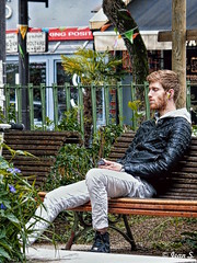 Listen to the music (Jean S..) Tags: candid man male music bench streetphotography park street outdoors beard