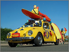 Water Beetle?? (Jason 87030) Tags: car vw volkswagen beetle yellow wheels surf bioard life guard lifeguard sunny weather parade carnival thanet margate kent uk england low composition pov viewpoint ilce screen shot shoot session color colour dummy doll blow bubble up down left right scene street roadside frame border vehicle fun