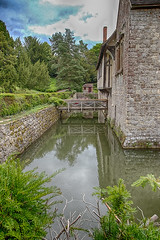 Ightham Mote - North Side (Geoff Henson) Tags: house manor mansion moat mote walls garden plants flowers water reflection clouds historic
