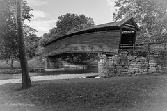 The Old Bridge in Summer (John H Bowman) Tags: virginia alleghanycounty bridges coveredbridges virginiacoveredbridges humpbackbridge multiplekingposttruss stonework nrhp nationalhistoriclandmark riversandstreams dunlapcreek weatheredwood bw june2015 june 2015 canon16354l