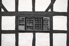 B&W Tudor Windows 3-0 F LR 6-23-18 J036 (sunspotimages) Tags: tutor window windows tutorwindow tutorwindows bw blackwhite blackandwhite monochrome buildings building architectural architecture