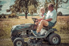 Slow Ride (freundsport) Tags: tractor traktor drive family summer people photo de rue personnage paysage landscape nature man farmer streetphoto street photography sky himmel fahrzeug women green red porsche funny flickr new free light sun sunny sonne sonnenschein streetlife magic outside outdoor sony7m3 sony7iii sony zeiss village germany clouds life reality farm farmland field bride