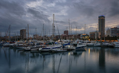 Alicante Marina Evening (henriksundholm.com) Tags: port harbor harbour landscape dusk clouds cloudy sky lake reflections boats marina yachts sailing shadows ripples city urban cityscape skyline alicante spain espana hdr