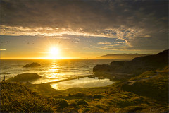 A Spacious Seascape under the Classical Sunset (milton sun) Tags: sutrobaths sanfrancisco dusk seascape bay ngc bayarea wave ocean shore seaside coast california northerncalifornia westcoast pacificocean landscape outdoor clouds sky water rock mountain rollinghills sea sand beach cliff nature sunset grass