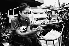 Eagle Eye (Meljoe San Diego) Tags: meljoesandiego ricoh grd4 grdiv streetphotography tricycle texting candid monochrome philippines