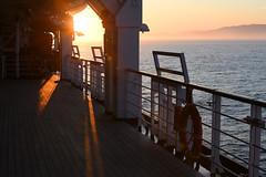 Sailing Into the Sunset (Anthony Mark Images) Tags: sunset sea ocean cruiseship mountains hollandamericalines mseurodam romantic lovely beautiful lifebuoy railing lifeboats deck waves shadows washington washingtonstate