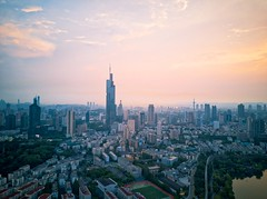 Zifeng Tower at Sunset (asusmt) Tags: zifeng city cityscape sky skyscraper skyline tower building architecture tall landmark transportation urban downtown sunset vivid drone aerial hdr lake water dusk twilight summer outdoor modern nanjing