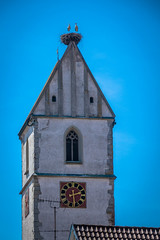Look at the next and birds on the top of this church.
