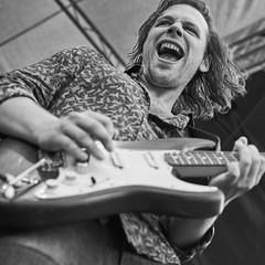 Rock'n'Roll ain't noise pollution (chribs) Tags: konzert concert guitar stage musik music musician artist rock portrait zeiss ze sonnartfe1855 bw sw