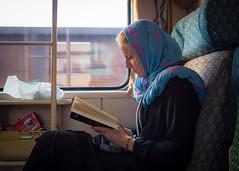 Train from Mashhad to Esfahan, Iran (TeunJanssen) Tags: train travel reading iran masshad esfahan isfahan book scarf dof traveling worldtravel backpacking worldtrip middleeast olympus omd omdem10 mashhad