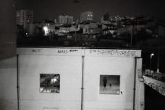 promener son chien à l'intérieur (asketoner) Tags: dog man silhouette friche marseille france night grain city cityscape buildings wall windows pale white inside outside