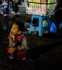 Longing (A. Yousuf Kurniawan) Tags: children kid kidworld night nightphotography portrait fair streetphotography urbanlife banjarbaru kalimantan borneo festival colourstreetphotography decisivemoment