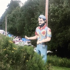 Hippie muffler man at Yasgur's farm (yooperann) Tags: roadside america muffler man woodstock hippie flowered shirt big large tiedye
