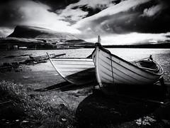 Three Keels on Nólsoy (Feldore) Tags: faroeislands nólsoy keel boats harbour faroe islands mountain landscape feldore mchugh em1 olympus 1240mm dramatic mono clouds sky water sea shapes shadows