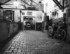 Garage at Beamish Museum (Hammerhead27) Tags: tourist daysgone grey mono monochrome bw blackandwhite vintage display show vehicle garage workshop cobbles old bicycle car england durham beamishmuseum