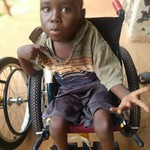Joseph Kinyera being fitted with his first wheelchair thumbnail