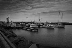 Line'em Up - Fishing Boats - Harbour (SNAPShots by Patrick J. Whitfield) Tags: boat fishingboat fisherman fishing water sea shores harbour ocean seaside waves wet docks lines patterns dof details texture outside nature landscape rural paysage ciel clouds skies cloudscapes old life buildings boats morning sunlight light contrast atmosphere history view blackandwhite blackwhite bnw bw monochrome noire noiretblanc fence stairs home village glass reflections shapes walking pier port sky