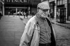 Checked (Leanne Boulton) Tags: people portrait urban street candid portraiture streetphotography candidstreetphotography candidportrait streetportrait eyecontact candideyecontact streetlife old elderly man male face eyes expression mood feeling emotion ire cap check pattern tone texture detail depthoffield bokeh naturallight outdoor light shade city scene human life living humanity society culture canon canon5dmkii 70mm ef2470mmf28liiusm black white blackwhite bw mono blackandwhite monochrome glasgow scotland uk