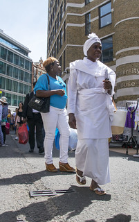 DSC_4280a Petticoat Lane Sunday Street Market London African Religious Nun in her White Habit and Christian Cross