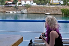 The Corinth Canal in Greece (Eleanna Kounoupa) Tags: ελλάδα πελοπόννησοσ ισθμόστησκορίνθου διώρυγατησκορίνθου θάλασσα νερό greece peloponnese corinthcanal isthmusofcorinth sea water boat πλοίο γυναίκα φωτογράφοσ χρωματιστάμαλλιά coloredhair woman photographer άνθρωποι people ίσθμια isthmia