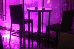 Waiting For The Asses (N A Y E E M) Tags: chair table ashtray night rain monsoon light neon availablelight atmosphere mood ambiance baikalbar radissonblu hotel chittagong bangladesh sooc raw unedited untouched handheld