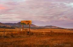 Sunset Drive (Marsha Kirschbaum) Tags: mileage coasthighway roadsigns sonyarii landscape clouds ©marshakirschbaum pink grasslands centralcoast coastalrange gold signage colorful highway1 red