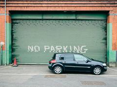 No Parking (Peter.Bartlett) Tags: vsco ricohgr unitedkingdom brick city doorway door peterbartlett shutter urban uk car wall urbanarte lunaphoto sign texting kodakportra160emulation facade manchester england gb