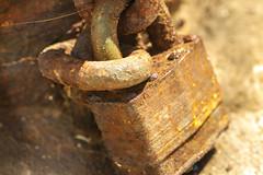 Locked out forever. (Karon Elliott Edleson) Tags: mondaysanythinggoes 7dwf lock rotting decay macromondays closeup rust old