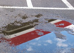 puddle 1 (ms. neaux neaux) Tags: dawnarsenaux puddles reflections outdoor photograph canon lines parkinglot 7eleven cement water clouds sky wet