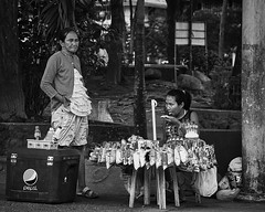 Tasting (Beegee49) Tags: street stall filipina watching eating snacks vendor silay city philippines