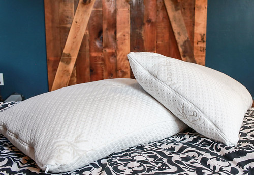 Two white pillows on a bed